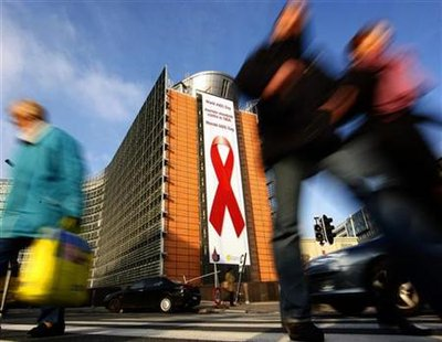 A giant banner with an Aids awareness red ribbon is displayed on the European Commission headquarters on World Aids Day in Brussels December 1, 2009. REUTERS/Yves Herman
