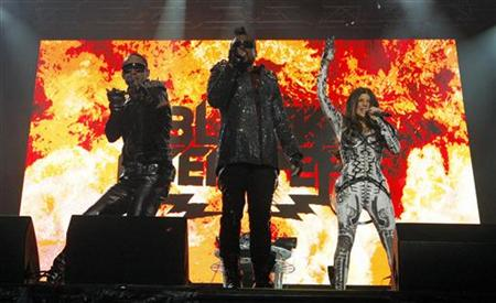 Taboo (L), apl.de.ap (C) and Fergie of the Black Eyed Peas perform during the Summer Festival in Quebec City July 16, 2010. REUTERS/Mathieu Belanger