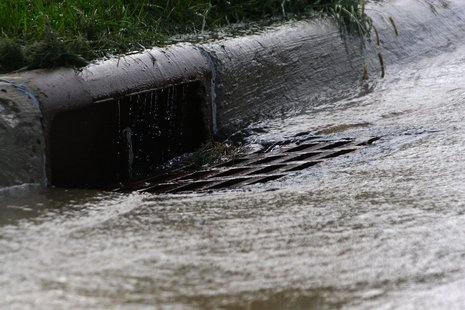 An overflowing storm drain.