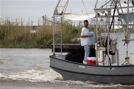 A fisherman stands on his boat near the Marina in Venice, Louisiana May 3, 2010. REUTERS/Carlos Barria