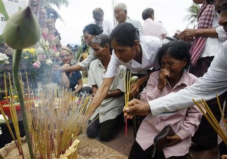 People offer incense during a Buddhist ceremony to commemorate the victims of the Khmer Rouge at Toul Sleng museum in Phnom Penh July 25, 2010. REUTERS/Chor Sokunthea