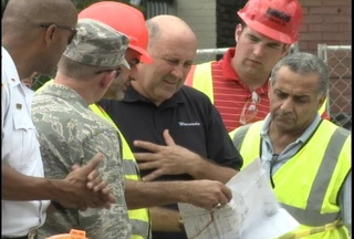 Governor Doyle surveys damage from flooding in Milwaukee County. (courtesy of FOX 11).