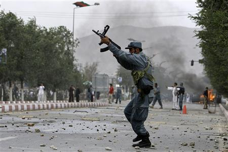 An Afghan policeman fires into the air during clashes with protesters following Friday prayers in Kabul July 30, 2010. REUTERS/Omar Sobhani