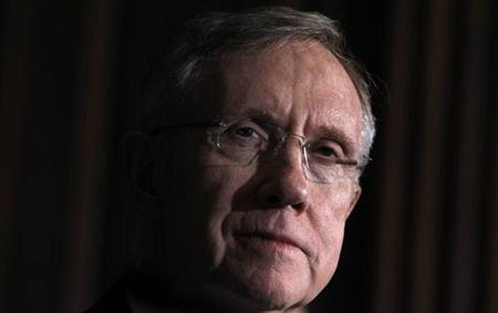 Senate Majority leader Harry Reid (D-NV) listens to remarks after the Senate approved a package of changes to President Barack Obama's landmark healthcare overhaul and sent the bill to the House of Representatives for final passage in Washington, March 25, 2010. REUTERS/Jim Young