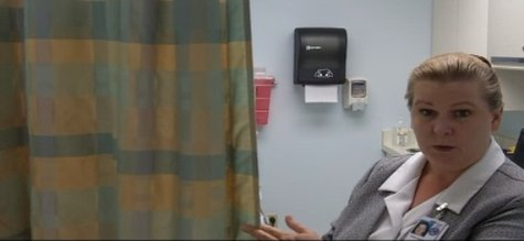 Nurse manager Kadie Sullivan explains how a privacy curtain protects veterans undergoing exams in one of several rooms at the Wausau VA clinic.