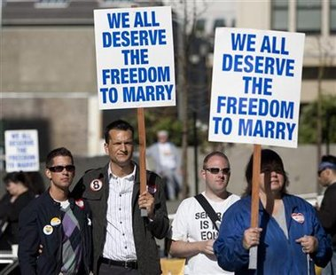 People rally outside a federal court house in support of California over turning a ban on same sex marriage in San Francisco, California, June 16, 2010. REUTERS/Kim White