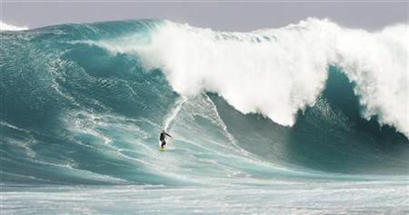 Australian surfer Mark Visser surfs an 11 metre (36 foot) wave at Cow Bombie, near the West Australian town of Gracetown, 280km (174 miles) south of Perth, in this handout photograph obtained September 28, 2009. REUTERS/Calum Macauley/Handout