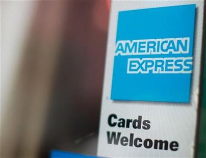 An American Express sign is seen on a restaurant door in New York in this July 22, 2010 file photo. REUTERS/Brendan McDermid