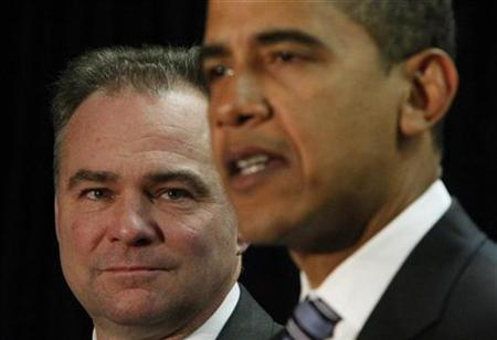 Virginia Governor Tim Kaine (L) listens to his introduction as the new Democratic National Committee chairman by President Barack Obama in Washington, January 8, 2009. REUTERS/Jim Young