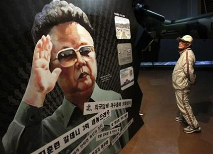 A man looks at a portrait of North Korean leader Kim Jong-il during the Korean War exhibition at the Korean War Memorial Museum in Seoul May 23, 2010. REUTERS/Jo Yong-Hak