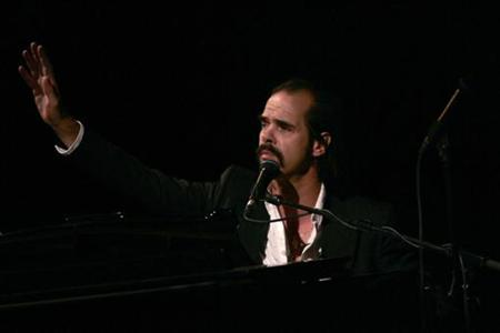 "Australian singer Nick Cave performs during his ""Solo show"" in Malaga, southern Spain, April 22, 2007. REUTERS/ Jon Nazca"