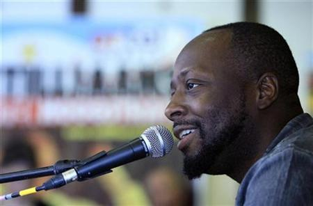 Haitian singer Wyclef Jean, a candidate for the next presidential election in Haiti, attends a news conference before his concert at the Antilliaanse Feesten music festival in Hoogstraten, August 13, 2010. REUTERS/Sebastien Pirlet