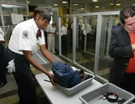A TSA worker at an airport security check-point.