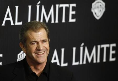 "Mel Gibson poses during the Spanish premiere of the film ""Edge of Darkness"" in Madrid February 1, 2010. REUTERS/Juan Medina"