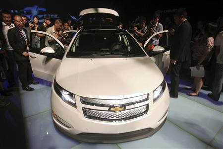 A General Motors Co. Chevrolet Volt is displayed during a ceremony at the Shanghai International Fashion Centre August 31, 2010. U.S. carmaker General Motors plans to launch its Chevrolet Volt electric car in China in the second half of 2011, Kevin Wale, president and managing director of GM China, said on Tuesday. REUTERS/Stringer