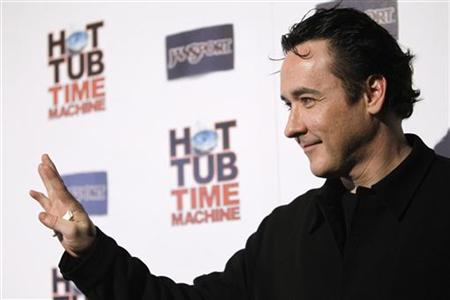"Cast member John Cusack waves at the premiere of ""Hot Tub Time Machine"" in Hollywood, California March 17, 2010. REUTERS/Mario Anzuoni"