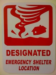A sign designating a tornado shelter.