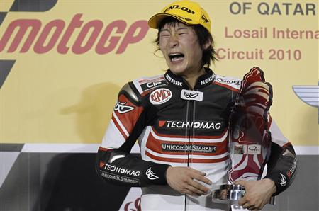 Suter rider Shoya Tomizawa of Japan holds up his trophy on the podium after winning the Moto2 race during the Qatar Grand Prix at the Losail international circuit in Doha in this April 11, 2010 file photo. REUTERS/Fadi Al-Assaad/Files