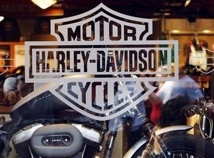 Motorcycle maker Harley Davidson's logo appears on the window of a store in Boston, Massachusetts July 17, 2008. REUTERS/Brian Snyder