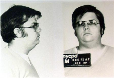 A mug-shot of Mark David Chapman, who shot and killed John Lennon, is displayed on the 25th anniversary of Lennon's death at the NYPD in New York December 8, 2005. REUTERS/Stringer