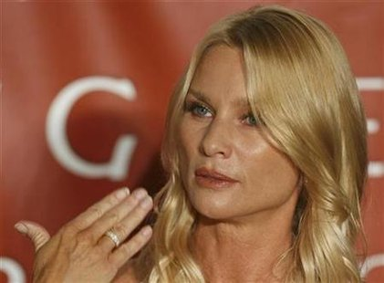 U.S. actress Nicollette Sheridan speaks during a news conference in Vienna February 18, 2009. REUTERS/Heinz-Peter Bader