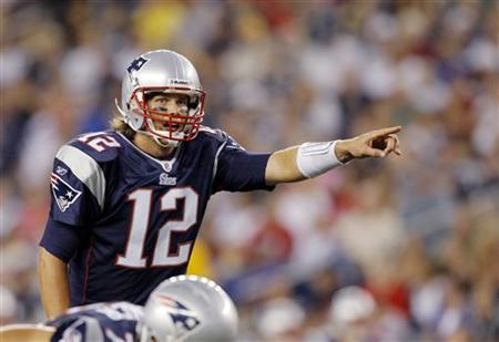 New England Patriots quarterback Tom Brady calls a play against the New Orleans Saints in the first quarter of their NFL pre-season football game in Foxborough, Massachusetts August 12, 2010. REUTERS/Brian Snyder