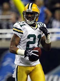 Green Bay Packers' Charles Woodson celebrates after he returned an interception for a score against the Detroit Lions during the second half of their Thanksgiving Day NFL football game in Detroit, Michigan November 26, 2009. REUTERS/Rebecca Cook