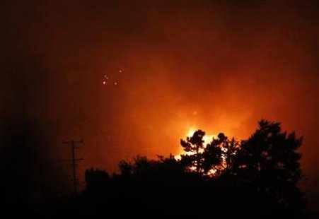 Flames rise as a neighborhood burns following a natural gas explosion in San Bruno, California September 9, 2010. Credit: Reuters/Robert Galbraith