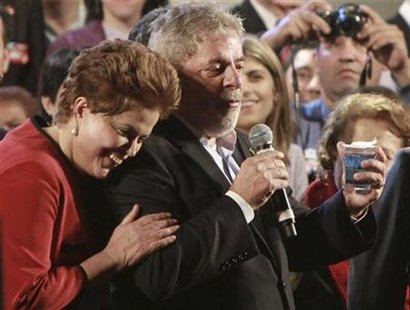 Brazil's President Luiz Inacio Lula da Silva (R) talks as the Brazil's ruling Workers' Party presidential candidate Dilma Rousseff smiles during a campaign rally in Porto Alegre September 24, 2010. REUTERS/Edison Vara
