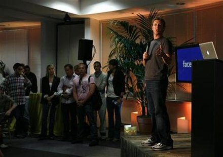 "Facebook CEO Mark Zuckerberg speaks while unveiling the company's new location services feature called ""Places"" during a news conference at Facebook headquarters in Palo Alto, California August 18, 2010. REUTERS/Robert Galbraith"