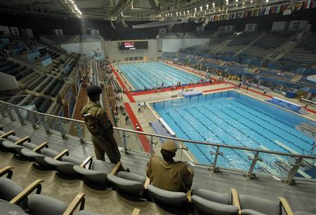 Policemen keep guard inside S. P. Mukherjee Aquatics Complex in New Delhi October 2, 2010. REUTERS/Krishnendu Halder
