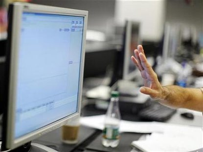 A man gestures before a computer screen in a file photo. REUTERS/Brian Snyder
