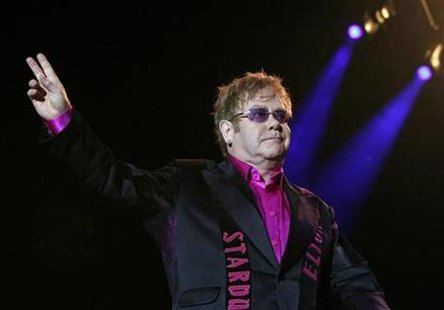 British singer Elton John greets the audience before his concert in Prague June 10, 2010. REUTERS/David W Cerny