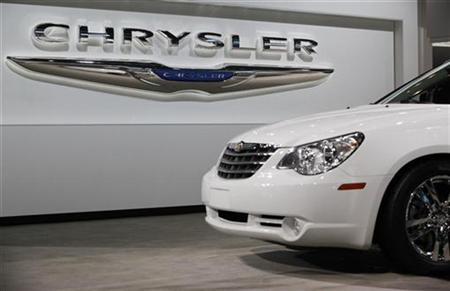 A Chrysler Sebring sits in front of the Chrysler logo at the New York International Auto Show in New York April 1, 2010. REUTERS/Jessica Rinaldi