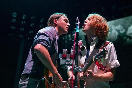 Guitarist Richard Parry (R) and singer Win Butler of Canadian band Arcade Fire perform at Madison Square Garden in New York August 4, 2010. REUTERS/Lucas Jackson