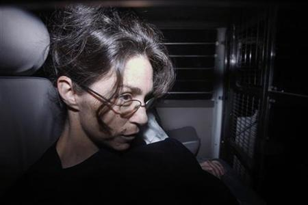 "Nancy Kissel, dubbed the ""milkshake"" murderess, sits in a prison van as she arrives at the Court of Final Appeal in Hong Kong, February 11, 2010. REUTERS/Bobby Yip"