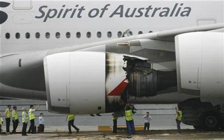 Technicians look at the damaged engine of Qantas Airways A380 passenger plane QF32 after it was forced to make an emergency landing at Changi airport in Singapore November 4, 2010. REUTERS/David Loh