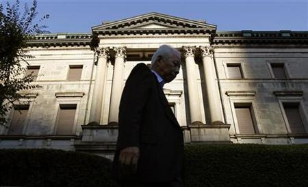 A man walks past the Bank of Japan headquarters in Tokyo November 4, 2010. REUTERS/Yuriko Nakao