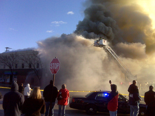 Crews fight a fire at West Side Liquor in Green Bay, Nov. 5, 2010. (courtesy of FOX 11)