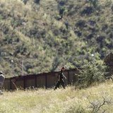 United States National Guard troops and a U.S. Border Patrol agent patrol along the U.S. and Mexico border in Nogales, Arizona in this October 8, 2010 file photo. REUTERS/Joshua Lott