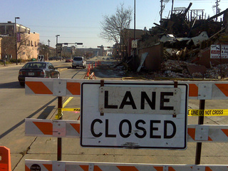 A lane of Walnut St. in Green Bay remains closed Nov. 9, 2010, four days after a massive fire destroyed a building. (courtesy of FOX 11).
