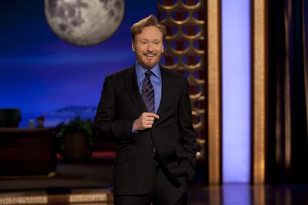 Comedian Conan O'Brien is shown on stage during the premiere of his new late night talk show on TBS 'Conan'at the Warner Bros. Studios in Burbank, California November 8, 2010 in this publicity photograph released by TBS. REUTERS/Meghan Sinclair/ Conaco LL/TBS/Handout