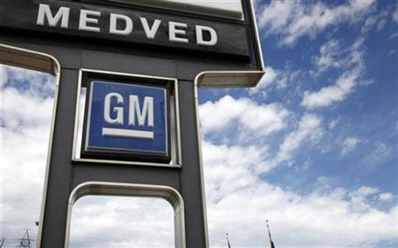 A GM sign is seen outside the Medved General Motors car dealership in Arvada, Colorado August 12, 2010. REUTERS/Rick Wilking