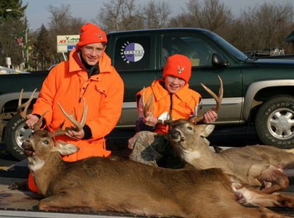 Two young deer hunters.