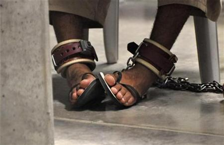 "In this photo, reviewed by a U.S. Department of Defense official, a Guantanamo detainee's feet are shackled to the floor as he attends a ""Life Skills"" class inside the Camp 6 high-security detention facility at Guantanamo Bay U.S. Naval Base April 27, 2010. REUTERS/Michelle Shephard/Pool"