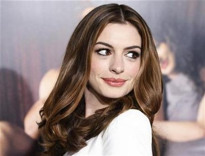 anne hathaway entertainment. Actress Anne Hathaway poses at