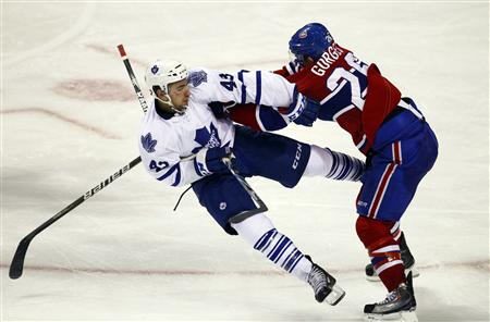 Montreal Canadiens Josh Gorges (R) collides with Toronto Maple Leafs Nazem Kadri during the third period of NHL hockey play in Montreal, November 20, 2010. REUTERS/Shaun Best