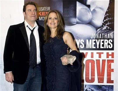 "Actor John Travolta and his wife Kelly Preston arrive at the premiere of ""From Paris With Love"" in Paris February 11, 2010. REUTERS/Gonzalo Fuentes"