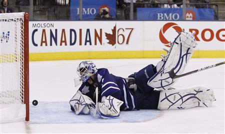 Toronto Maple Leafs goalie Jonas Gustavsson lets in a goal by Tampa Bay Lightning's Martin St. Louis during the third of their NHL hockey game in Toronto November 30, 2010. REUTERS/Mark Blinch