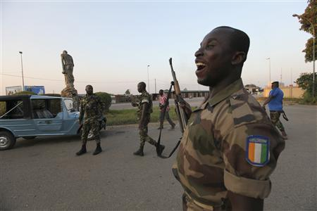 Ivory Coast rebels celebrate at their headquarters in their stronghold in Bouake, central Ivory Coast, December 3, 2010. REUTERS/Luc Gnago